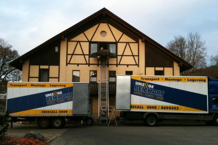 Bild von Haus und Umzugswagen